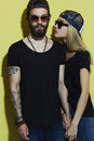 Fashion beautiful couple in hat together. Hipster boy and girl Royalty Free Stock Photo