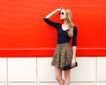 Fashion beautiful woman model in leopard skirt and sunglasses Royalty Free Stock Photo