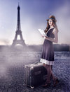 Fashion beautiful woman in paris france young traveler a straw hat with a brown suitcase wearing dress read guide to Stock Photography