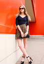 Fashion beautiful young woman model in leopard skirt Royalty Free Stock Photo
