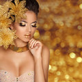 Fashion Beauty Girl portrait with flowers Isolated on golden Royalty Free Stock Photo