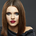 Fashion Beauty Portrait of Young Woman on Gray Bac Royalty Free Stock Photo