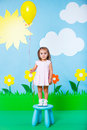 Fashion and beauty summer theme lovely baby girl wearing colorful dress with balloon on Royalty Free Stock Photography