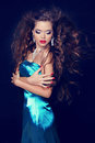 Fashion beauty vogue model girl in elegant blue dress with blowi blowing wavy hair Royalty Free Stock Photography