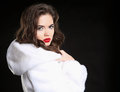 Fashion beauty woman in white fur coat isolated on black studio Royalty Free Stock Photo