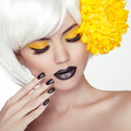 Fashion blond model girl portrait with trendy short hair style black make up and manicure black nails polish and lipstick woman Stock Images