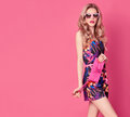 Fashion Blond Model in Summer Jumpsuit on Pink Royalty Free Stock Photo