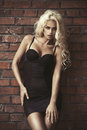 Fashion blond woman over brick wall Royalty Free Stock Photo
