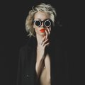Fashion blonde with bright makeup and accessories photo of beauty Royalty Free Stock Photography