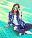 Fashion brunette woman in casual checkered shirt Royalty Free Stock Photo