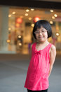 Fashion child little asian girl in red dress Royalty Free Stock Photo