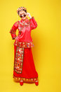 Fashion chinese style —— human figures photography belle wearing ancient costume on yellow background Stock Image