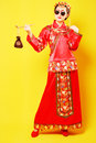 Fashion chinese style suit belle wearing ancient costume on yellow background Royalty Free Stock Images