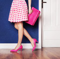 Fashion concept girl wearing high heels and holding a bag walking out Stock Images