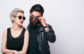 Fashion couple in leather clothes posing in studio Royalty Free Stock Photo