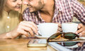 Fashion couple of young lovers at cafe bar cafeteria Royalty Free Stock Photo