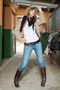 Fashion cow girl in an stable Stock Photography