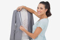 Fashion designer measuring blazer lapel on white background Royalty Free Stock Image
