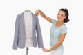 Fashion designer measuring blazer sleeve on mannequin and smiling white background Stock Photo
