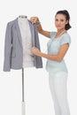 Fashion designer measuring blazer on white background Royalty Free Stock Images