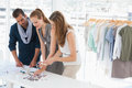 Fashion designers discussing designs in studio group of a Stock Photos