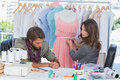 Fashion designers working together on a dress Royalty Free Stock Photo