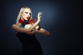Fashion elegant blond lady in stylish clothes on a dark background Royalty Free Stock Photo