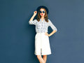 Fashion elegant lady woman wearing a black sunglasses, hat and white skirt Royalty Free Stock Photo