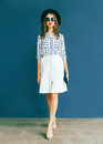 Fashion elegant woman in black round hat, white skirt Royalty Free Stock Photo