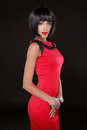 Fashion Elegant Woman in red dress. Brunette Lady with Black Sho Royalty Free Stock Photo
