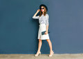Fashion elegant woman wearing a black hat and white skirt Royalty Free Stock Photo