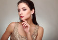 Fashion female model looking sexy with hand near face Royalty Free Stock Photo
