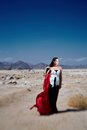 Fashion girl in the desert of egypt in a beautiful dress Stock Photography