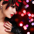 Fashion girl with feathers glamour young woman with red lipstic lipstick and lace gloves over bokeh background portrait evening Royalty Free Stock Photography