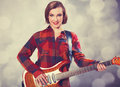 Fashion girl with guitar photo in s style Royalty Free Stock Image