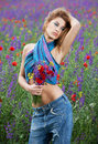 Fashion girl posing in spring flowers Royalty Free Stock Photography