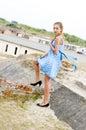 Fashion girl urbex location blue polka dress Royalty Free Stock Photography