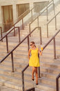 Fashion girl walking with orange cocktail Royalty Free Stock Photo