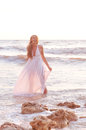 Fashion girl in a white dress beautiful happy the sea Royalty Free Stock Photo