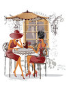 Fashion girls in the street cafe. Royalty Free Stock Photo