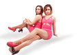 Fashion girls two women in pink with non matching shoes Stock Photo