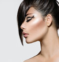 Fashion glamour beauty girl with stylish hairstyle and makeup Stock Image
