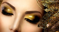 Fashion glamour makeup holiday gold glittering eyeshadows Royalty Free Stock Photo