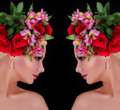 Fashion hairstyle girl with roses beautiful young woman with flowers in her hair over black background Royalty Free Stock Photo