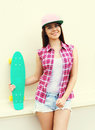 Fashion hipster cool girl in colorful pink clothes with skateboard having fun Royalty Free Stock Photo