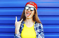 Fashion hipster cool girl in sunglasses and colorful clothes having Royalty Free Stock Photo
