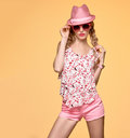 Fashion Hipster girl.Crazy Cheeky emotion.Pink Hat Royalty Free Stock Photo