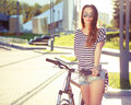 Fashion Hipster Woman with Bicycle in the City Royalty Free Stock Photo