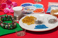 Fashion jewellery colored jewelery on the red table Royalty Free Stock Photo