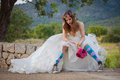 Fashion jilted teen bride in wedding dress and sneakers Royalty Free Stock Image